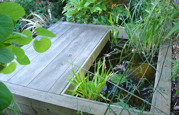 pond with seating area in city garden - carol whitehead garden design