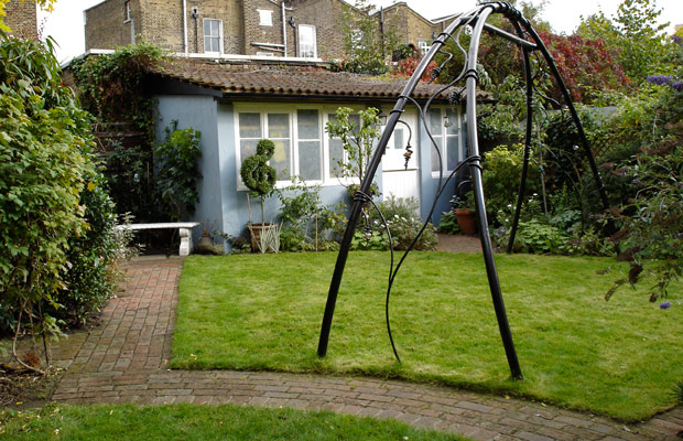 Bespoke ornamental arch in family garden - Carol Whitehead garden design