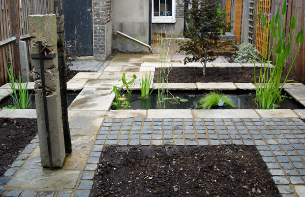 Cobbles and slabs around pond - Carol Whitehead garden design