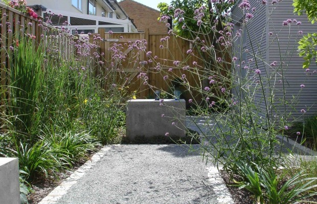 A concrete seat and minimal, chic paths - Carol Whitehead garden design