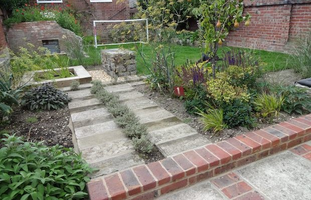 Herb path near pear tree with recycled path - Carol Whitehead garden design