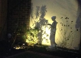 night lit statue in courtyard garden