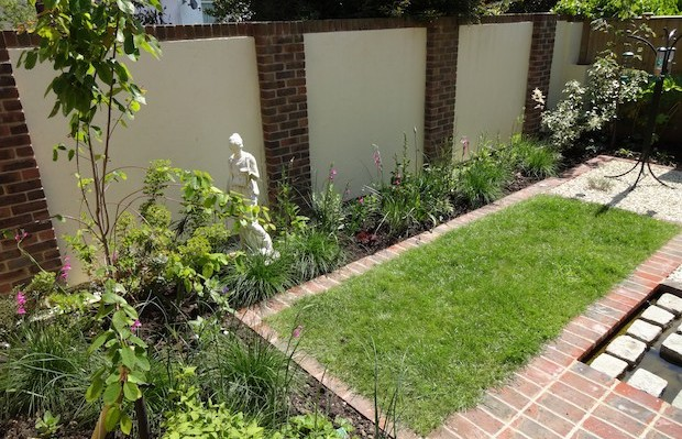 Old town courtyard back wall with render and brick pillars - Carol Whitehead garden design