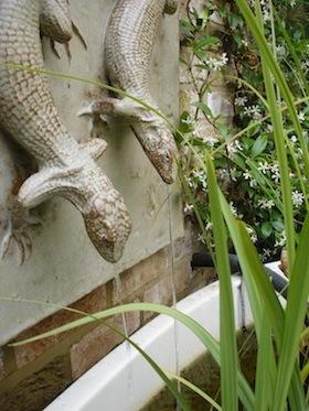 wildlife ponds in small gardens ceramic lizards wall mounted in a wildlife pond for small garden