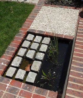 wildlife ponds in small gardens cobbles and brick in wildlife pond