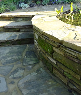 raised circular wildlife pond detail of recycled York stone with step detail